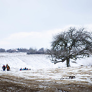 In subfreezing snowy weather, refugees walk the unofficial refugee crossing from the Tabanovce, Macedonia Train Station across the Serbian border.  A daily average of 2,400 refugees have crossed into Serbia throughout the winter.  Warmer months saw highs of 10,000 arrivals. Limited to what belongings they can carry with them, many have gone without food and water for extended periods. They have escaped their own country in conflict, taken a perilous boat ride from Turkey to Greece, and then moved onward through disorienting foreign lands in search of a peaceful home. Most refugees are headed to welcoming Germany. They are from  Afghanistan, Iraq, and Syria, with a wide range of socioeconomic backgrounds. Economic migrants also arrive in Macedonia and Serbia, but without the proper papers they are turned back, while some find smugglers to take them further into Europe. Near Miratovac, Serbia, January 2016.