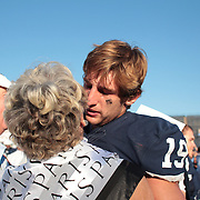 Yale Quarterback Morgan Roberts is embraced at the end of the game during the Yale V Army, Football match at Yale Bowl, New Haven. Yale won the match 49-43 in overtime in front of a crowd of 34,142. New Haven, Connecticut, USA. 27th September 2014. Photo Tim Clayton