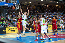 Bojan Dubljevic of Montenegro and Edo Muric of Slovenia during friendly match between National teams of Slovenia and Montenegro for Eurobasket 2013 on August 23, 2013 in Arena Bonifika, Koper, Slovenia. (Photo by Matic Klansek Velej / Sportida.com)