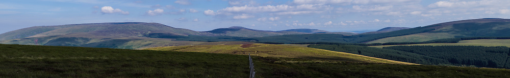 Windy Gyle, Cheviot Hills, UK. 13th August 2015. Looking east along the Scottish English border.