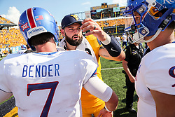 Oct 6, 2018; Morgantown, WV, USA; West Virginia Mountaineers quarterback Will Grier (7) talks with Kansas Jayhawks quarterback Peyton Bender (7) and Kansas Jayhawks quarterback Carter Stanley (9) after the game at Mountaineer Field at Milan Puskar Stadium. Mandatory Credit: Ben Queen-USA TODAY Sports