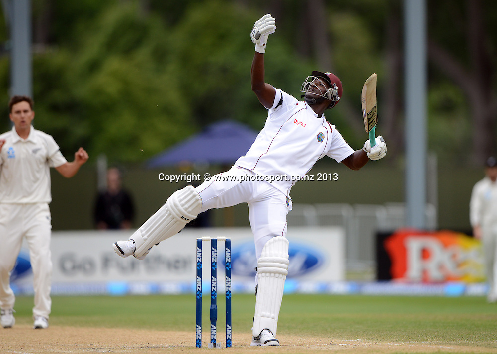 Darren Sammy off balance on Day 5 of the 1st cricket test match of the ANZ Test Series. New Zealand Black Caps v West Indies at University Oval in Dunedin. Saturday 7 December 2013. Photo: Andrew Cornaga/www.Photosport.co.nz