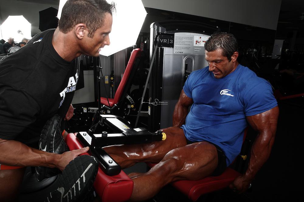 Bodybuilders Dan Decker and Brian Yersky doing leg extensions.