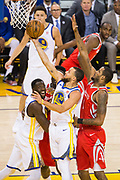 Golden State Warriors guard Stephen Curry (30) lays the ball into the basket against the Houston Rockets during Game 6 of the Western Conference Finals at Oracle Arena in Oakland, Calif., on May 26, 2018. (Stan Olszewski/Special to S.F. Examiner)