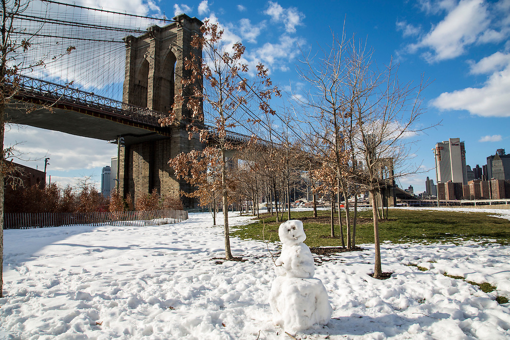 A snowman in Main Street Park surrounded by snow in front of Brooklyn Bridge in Dumbo, Brooklyn, New York City, United States of America. <br /> (photo by Andrew Aitchison / In pictures via Getty Images)