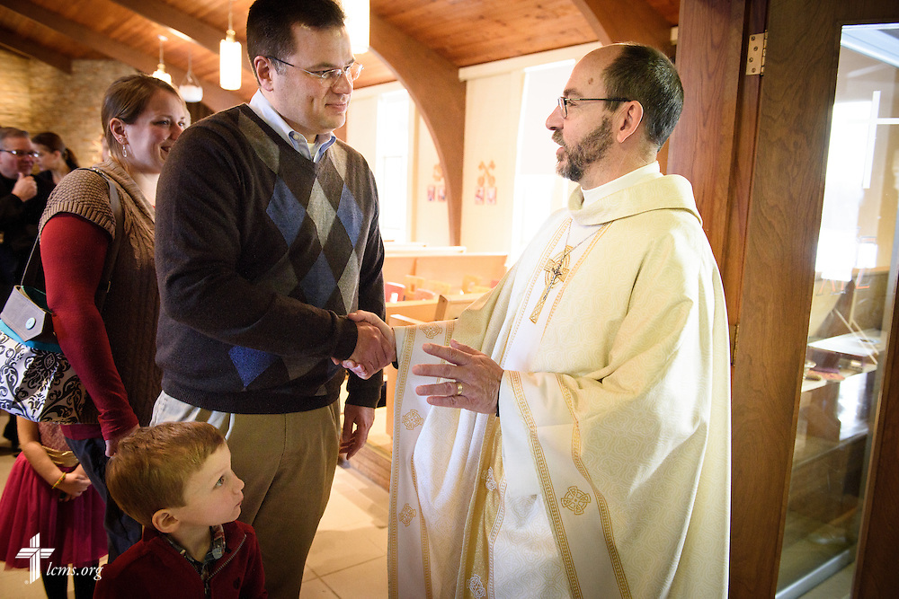 The Rev. Peter Bender, pastor of Peace Lutheran Church in Sussex, Wis., greets Michael Vogt and his family following worship on Transfiguration Sunday, Feb. 7, 2016, at the church in Sussex. LCMS Communications/Erik M. Lunsford