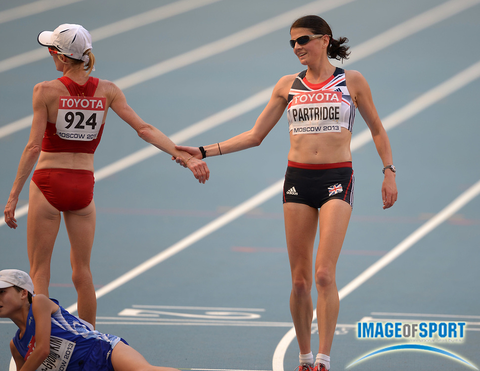 Aug 10, 2013; Moscow, RUSSIA; Deena Kastor (USA), left, congratulates Susan Partridge (GBR) at the end of the womens marathon in the 14th IAAF World Championships in Athletics at Luzhniki Stadium.