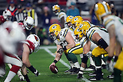 The Green Bay Packers offensive line gets set to snap the ball at the line of scrimmage opposite the Arizona Cardinals defensive line during the NFL NFC Divisional round playoff football game against the Arizona Cardinals on Saturday, Jan. 16, 2016 in Glendale, Ariz. The Cardinals won the game in overtime 26-20. (©Paul Anthony Spinelli)