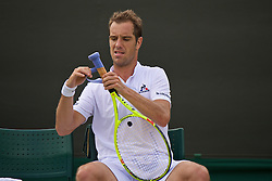LONDON, ENGLAND - Tuesday, June 28, 2016: Richard Gasquet (FRA) tapes a new grip to his Head racquet during the Gentlemen's Singles 1st Round match on day two of the Wimbledon Lawn Tennis Championships at the All England Lawn Tennis and Croquet Club. (Pic by Kirsten Holst/Propaganda)
