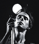 PICTURE BY HOWARD BARLOW..ARTIST - TOM VERLAINE of TELEVISION.VENUE   - MANCHESTER FREE TRADE HALL.DATE    - 26 MAY 1977