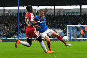 Lee Brown (3) of Portsmouth is challenged by Mikael Ndjoli (10) of Gillingham during the EFL Sky Bet League 1 match between Portsmouth and Gillingham at Fratton Park, Portsmouth, England on 12 October 2019.
