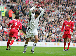LIVERPOOL, ENGLAND - SUNDAY MARCH 27th 2005: Celebrity XI's Patrick McGuiness holds his head in his hands after scoring an own goal as Liverpool Legends' Robbie Folwer looks on during the Tsunami Soccer Aid match at Anfield. (Pic by David Rawcliffe/Propaganda)