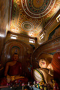 The Reclining and Seated Buddha in the main Image House. Note the beautifully painted walls and timber ceiling. Isipathanaramaya Buddhist Temple in Havelock Town, Colombo 5.