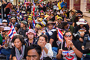 "14 JANUARY 2014 - BANGKOK, THAILAND: Anti-government protestors block the sidewalk in front of Royal Thai Police headquarters. Hundreds of protestors picketed police headquarters because they accuse the police of siding with the government during the protests. Tens of thousands of Thai anti-government protestors continued to block the streets of Bangkok Tuesday to shut down the Thai capitol. The protest, ""Shutdown Bangkok,"" is expected to last at least a week. Shutdown Bangkok is organized by People's Democratic Reform Committee (PRDC). It's a continuation of protests that started in early November. There have been shootings almost every night at different protests sites around Bangkok, but so far Shutdown Bangkok has been peaceful. The malls in Bangkok are still open but many other businesses are closed and mass transit is swamped with both protestors and people who had to use mass transit because the roads were blocked.     PHOTO BY JACK KURTZ"