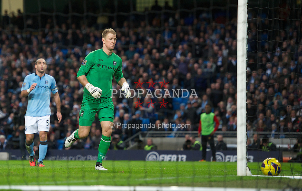 MANCHESTER, ENGLAND - Sunday, February 3, 2013: Manchester City's goalkeeper Joe Hart looks relieved as Pablo Zabaleta's back-pass goes wide during the Premiership match at the City of Manchester Stadium. (Pic by David Rawcliffe/Propaganda)