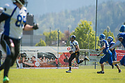 Luzern Lions quarterback Alex Bridgford (17) runs with the ball in their match against the Zürich Renegades