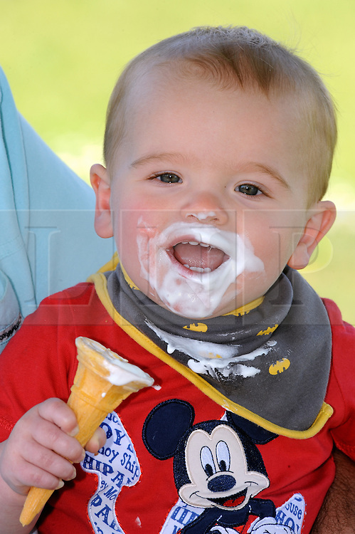 © Licensed to London News Pictures. 16/05/2014<br /> Kieran (age 1) from Gravesend happy with an Icecream.<br /> Sunny weather in Gravesend today(16.05.2014)<br /> Today is the start of a mini heatwave weekend with temperatures set to hit 24C across parts of the UK.<br />  People enjoying the hot weather at Gravesend Riverside,Gravesend,Kent  with the temperature at 21C in Gravesend today it is normally one of the hottest places in the UK, with views of the River Thames and Tilbury Power Station.<br /> Photo credit :Grant Falvey/LNP