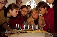 16 NOV 1999, BERLIN/GERMANY:<br /> Christine Bergmann, SPD, Bundesfamilienministerin, pustet mit Schülern Kerzen auf einer Torte, gebacken zum 10. Jahrestages der UN-Kinderrechtskonventionen, aus, Grundschule Berlin-Mitte, Ruppiner Str. 48/49<br /> Christine Bergmann, SPD, Fed. Minister for Family, Old People, Women and Youth, with pupils, during the visitation of a school, in cause of the 10th anniversary of the UN Childrens Rights Convention <br /> IMAGE: 19991116-02/01-31<br /> KEYWORDS: Kind, Child, Kuchen, cake