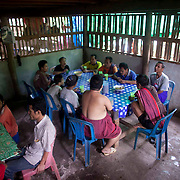 Former soldiers with the Karen National Liberation Army, who have been injured by landmines, gather for tea and snacks at the Men's Handicapped Ward at Mae Hla, Thailand refugee camp Wednesday, Aug. 17, 2011.  Sixteen landmine victims call the ward home.  All but two have been blinded by a landmine explosion.  he KNLA has been fighting a civil war against the government of Myanmar for since 1949.   (Photo by David Longstreath)(Photo by David Longstreath)
