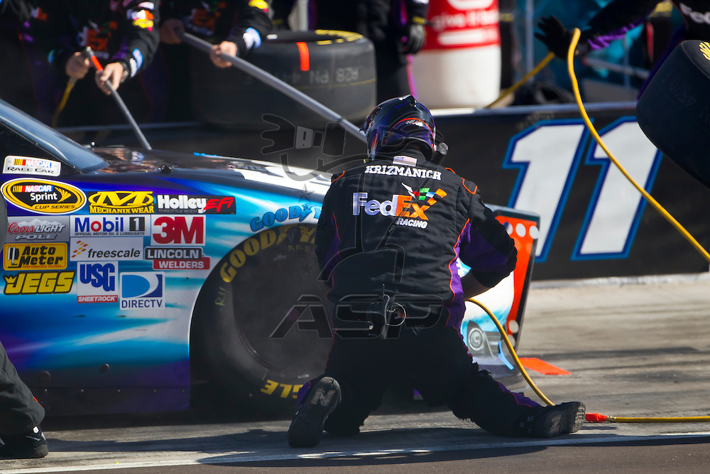 AVONDALE, AZ - MAR 04, 2012:  Denny Hamlin (11) brings his FedEx Toyota in for service during the Subway Fresh Fit 500 race at the Phoenix International Raceway in Avondale, AZ.