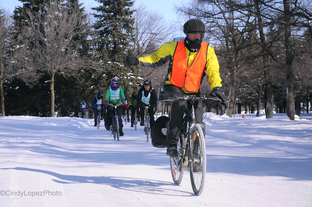 A cyclist braces -20 conditions riding through Maisonneuve Park in the 2nd Edition of the Velo Sous Zero. Nearly 1000 participants rode their bikes in frigid conditions. (Published in Cult MTL. February 2015).