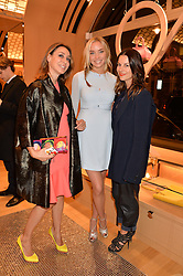 Left to right, SOFIA BARATTIERI, NOELLE RENO and JULIET ANGUS at the opening party for Moynat's new Maison de Vente in Mayfair at 112 Mount Street, London W1 on 12th March 2014.