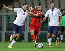 October 6, 2017 - Turin, Italy - Giorgio Chiellini (L) of Italy national team and Ilija Nestorovski of FYR Macedonia national team vie for the ball during the 2018 FIFA World Cup Russia qualifier Group G football match between Italy and FYR Macedonia at Stadio Olimpico on October 6, 2017 in Turin, Italy. (Credit Image: © Mike Kireev/NurPhoto via ZUMA Press)