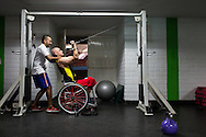 2016/03/23 &ndash; Medellín, Colombia: Oscar Rios, 42, does exercises with the help of his fitness coach on the Envigado Gymnasium, Medellin, 23rd March, 2016.<br /> -<br /> After his military service Oscar started to work as a bodyguard for a public prosecutor, a time of great violence in Medellin, during the 1990&rsquo;s when Pablo Escobar ran the city. <br /> On an assassination attempt of the public prosecutor, Oscar was shot seven times by Escobar&rsquo;s assassins. As a result he lost the mobility of his legs and feet, becoming paraplegic. <br /> The adaptation to a new life was hard, but he decided that he had to separate the injury under his waist from his head, and to keep doing what he wanted. Oscar had always liked basketball, so he decided to dedicate himself to it. In 1998 he became part of Team Colombia on wheelchair basketball. During his successful career he was several time South American Champion, was with Colombia on the top ten teams at the 2014 World Championship in Korea and went to the 2012 Paralympic Games in London. Unfortunately, this year Colombia missed the qualification for the Rio 2016 Paralympic, which was Oscar last opportunity to be back at an Olympics. <br /> He plans to retire soon and became a full-time basketball coach. Oscar believes that there is much talent in Colombia that needs to be fostered. When asked about the accident and his life on the wheelchair, Oscar says, &ldquo;Before I was an arrogant person and didn&rsquo;t have any love to give to my family. The accident was a blessing that made me a better, happier man and to appreciate more my life and family. If I was going to be born tomorrow, I wanted to be born on a wheelchair&rdquo;. (Eduardo Leal)
