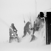 Jackson Hole Mountain Resort Employees braves the wind to remove snow from around Corbet's Cabin.