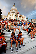 Tourists on the steps outside the US Capitol Building on Capitol Hill. The Congress Building is divided into the Senate and the House.