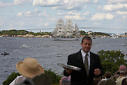 Newport, RI 2007 - Waiter at Castle hill serves the crowd gathered to watch Tallships from around the world parade out the bay at the end of the 2007 Tallships festival.