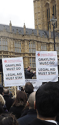 Dave Rowntree , the Blur drummer, makes a short speech to lawyers during their demonstration against cuts in legal aide outside Parliament in Westminster , London, United Kingdom. Friday, 7th March 2014. Picture by Max Nash / i-Images
