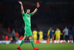 Arsenal goalkeeper Petr Cech applauds the fans after the final whistle during the UEFA Europa League round of 32 second leg match at the Emirates Stadium, London.