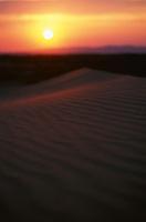 Sunrise across the sand dunes in the Gobi Desert, Mongolia.
