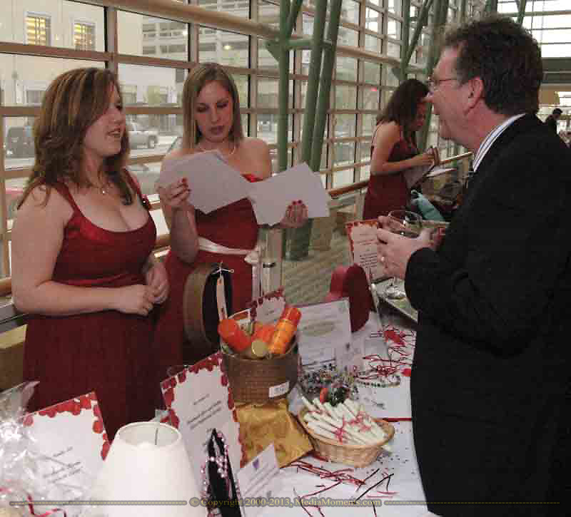 Robert Menz, from Sidney (right) talks to Heidi Custer, from Centerville and Tiffany Kracirick, from Dayton during the silent auction at the 2007 Wellness Connection Red Dress Gala, at the Schuster Performing Arts Center in Dayton, Saturday night, May 5th.
