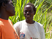 Ana Grace Amongin (left) with one of her Send a Cow group members. Ana's husband was killed by rebels leaving her to look after their 10 children, with no income. She managed to survive the famine by working in other peoples gardens. She heard about Send a Cow through her community. With their training and support she has been able to establish a farm on her husbands land, educate all her children and she now teachers others the skills she has learnt.