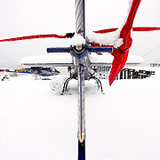 A Eurocopter A-stars sits on the pad waiting to take skiers into the southern Chugach.