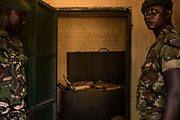 Rangers stand by seized ivory at Garamba National Park Headquarters on November 28, 2017.