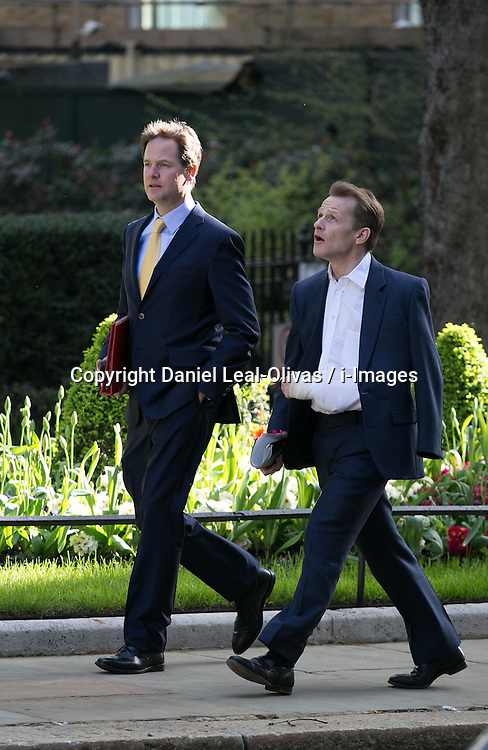 Nick Clegg (R) the Deputy Prime Minister of the United Kingdom arrives for the cabinet meeting at 10 Downing Street, London, United Kingdom. Tuesday, 8th April 2014. Picture by Daniel Leal-Olivas / i-Images