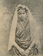 Woman with veil and ornate jewellery.<br />