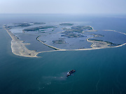 Nederland, Flevoland, Markermeer, 26-08-2019; Marker Wadden in het Markermeer. Overzicht, gezien  vanuit het Zuiden. Doel van het project van Natuurmonumenten en Rijkswaterstaat is natuurherstel, met name verbetering van de ecologie in het gebied, in het bijzonder de kwaliteit van bodem en water<br /> Naast het hoofdeiland is er inmiddels een tweede eiland in wording, de uiteindelijk Marker Wadden archipel zal uit vijf eilanden bestaan. <br /> Marker Wadden, artifial islands. The aim of the project is to restore the ecology in the area, in particular the quality of soil and water.<br /> The first phase of the construction, the main island, is finished. <br /> <br /> luchtfoto (toeslag op standard tarieven);<br /> aerial photo (additional fee required);<br /> copyright foto/photo Siebe Swart