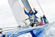 A crewman on the bow of the super maxi yacht 'Wild Thing', gestures to the boat carrying members of the media to move as they collide after the start of the Sydney to Hobart yacht race in Sydney, Australia. 'Wild Thing' did not sustain any major damage and went on to finish the race in fifth place overall.