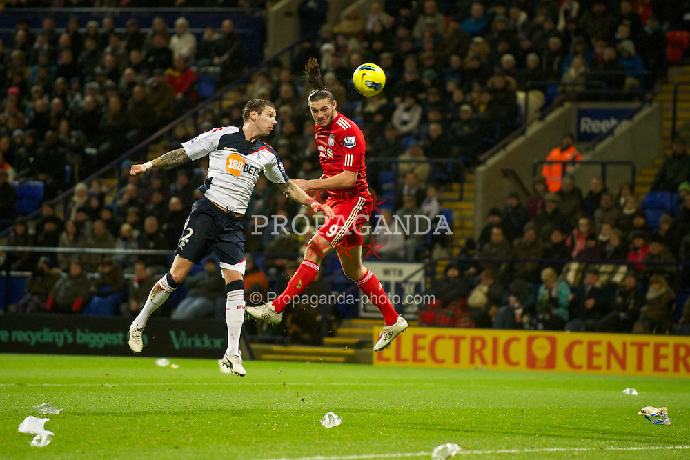 BOLTON, ENGLAND - Saturday, January 21, 2011: Liverpool's Andy Carroll in action against Bolton Wanderers' Gretar Rafn Steinsson during the Premiership match at the Reebok Stadium. (Pic by David Rawcliffe/Propaganda)