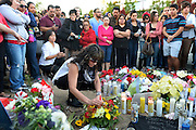 Dec. 1, 2013 - CA, USA -<br /> <br /> Paul Walker Crash Site Becomes Memorial<br /> <br />  Daly(cq) Manning places a candle at a memorial for Paul Walker and Roger Rodas, Sunday, December 1, 2013, at the scene of their fatal crash site on Hercules Street near Kelly Johnson Parkway in Valencia.<br /> ©exclusivepix