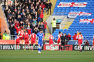 Charlton Athletic's Tony Watt (32 on left) celebrates with the away fans and his teammates after he scores his teams 1st goal to make it 1-1. Skybet football league championship match, Cardiff city v Charlton Athletic at the Cardiff city Stadium in Cardiff, South Wales on Saturday 7th March 2015.<br /> pic by Andrew Orchard, Andrew Orchard sports photography.
