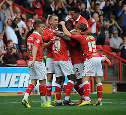 Bristol City's Kieran Agard celebrates with his team mates after scoring. - Photo mandatory by-line: Dougie Allward/JMP - Mobile: 07966 386802 - 27/09/2014 - SPORT - Football - Bristol - Ashton Gate - Bristol City v MK Dons - Sky Bet League One