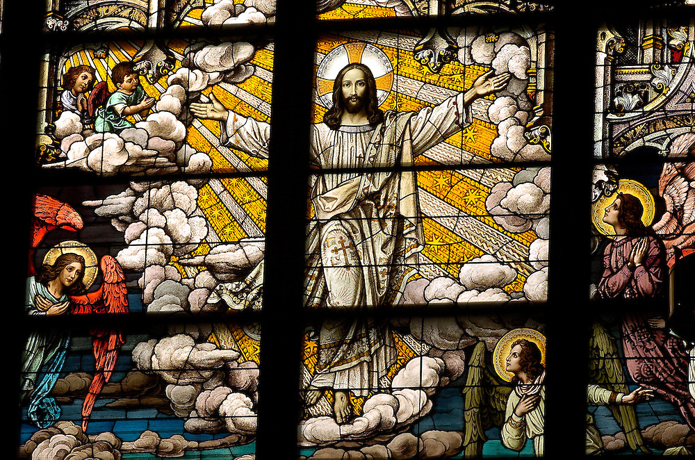 RESURRECTION OF CHRIST -- A stained glass image of the resurrected Christ inside Gesu Church, located at Marquette University, Milwaukee. (Photo by Sam Lucero)
