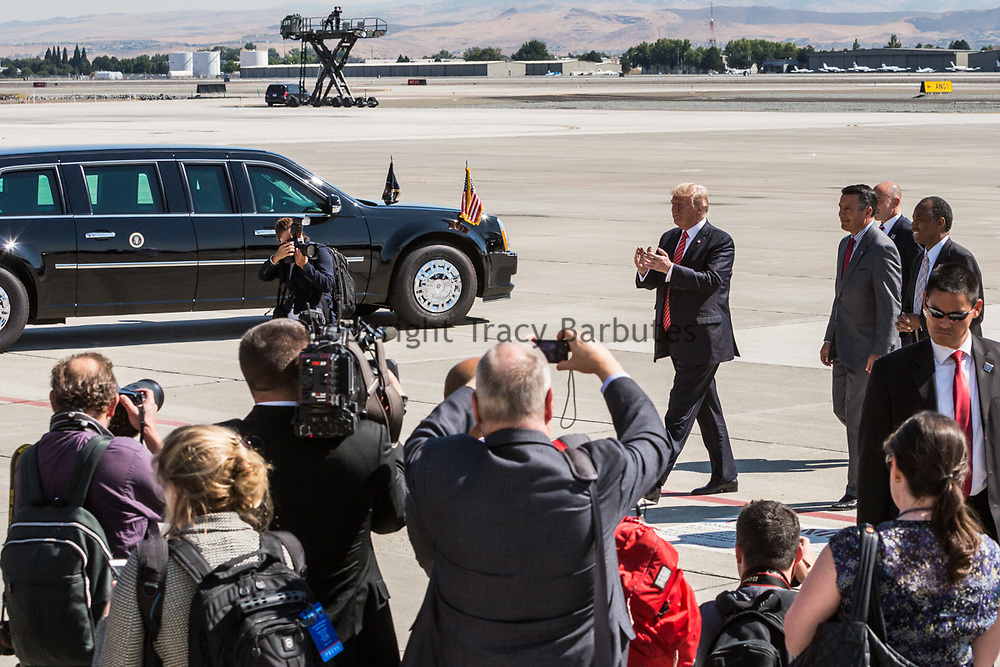 PRESIDENT DONALD J. TRUMP claps his hand as he walks toward VIP guests at the Reno, Nevada, airport on Wednesday, August 23, 2017. Trump is speaking at the American Legion convention at the Reno-Sparks Convention Center. The American Legion is a war time veterans association that often holds its annual convention at the Reno-Sparks Convention Center.