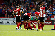 Callum Robinson of Sheffield United goes down after taking a knock during the Premier League match between Sheffield United and Crystal Palace at Bramall Lane, Sheffield, England on 18 August 2019.