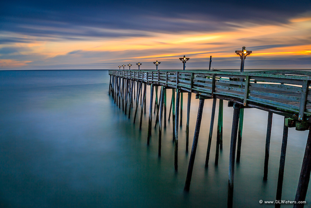 Long exposure of Kitty Hawk Pier at sunrise on the Outer Banks of NC.